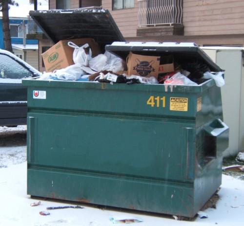 overfull dumpster